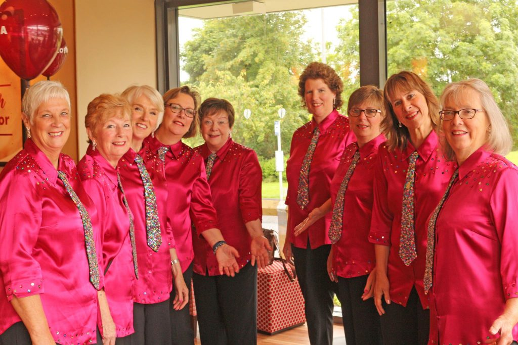 The group in raspberry pink shirts